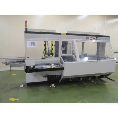 Used continuous Marchesini case packer model MA 315 second-hand cosmetic and pharmaceutical industrial equipment - left side