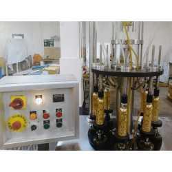 1936 - Ligne semi-automatique de fabrication de parfum Vatron Mau