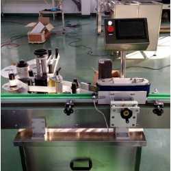 1551 - Automatic round bottle labeling machine