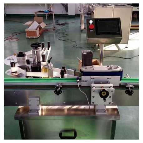 1551 - Automatic round bottle labeling machine